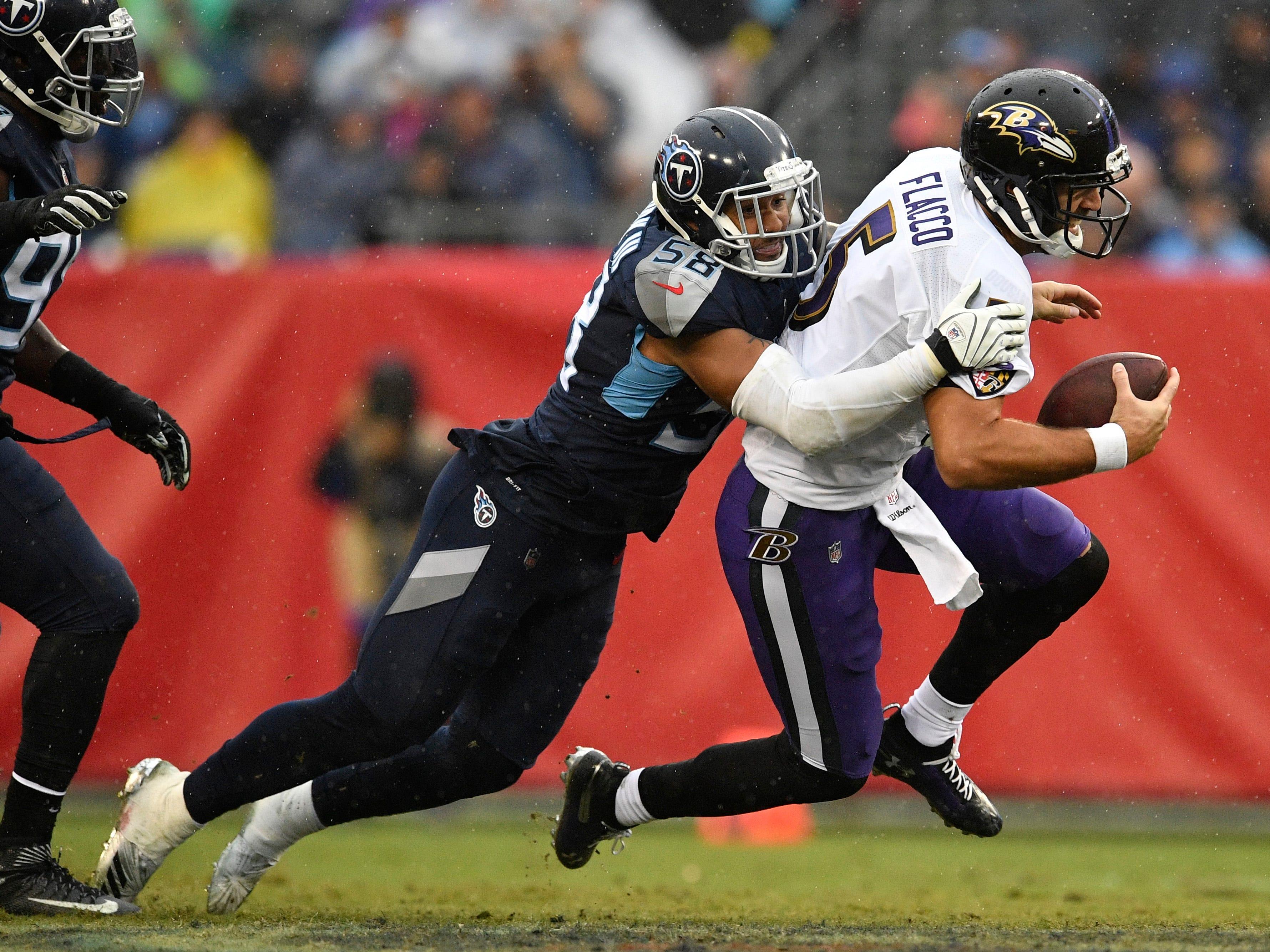Titans linebacker Harold Landry (58) drops Ravens quarterback Joe Flacco (5) in the second quarter at Nissan Stadium Sunday, Oct. 14, 2018, in Nashville, Tenn.