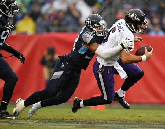 Titans linebacker Harold Landry (58) drops Ravens quarterback Joe Flacco (5) in the second quarter of a game Oct. 14, 2018.