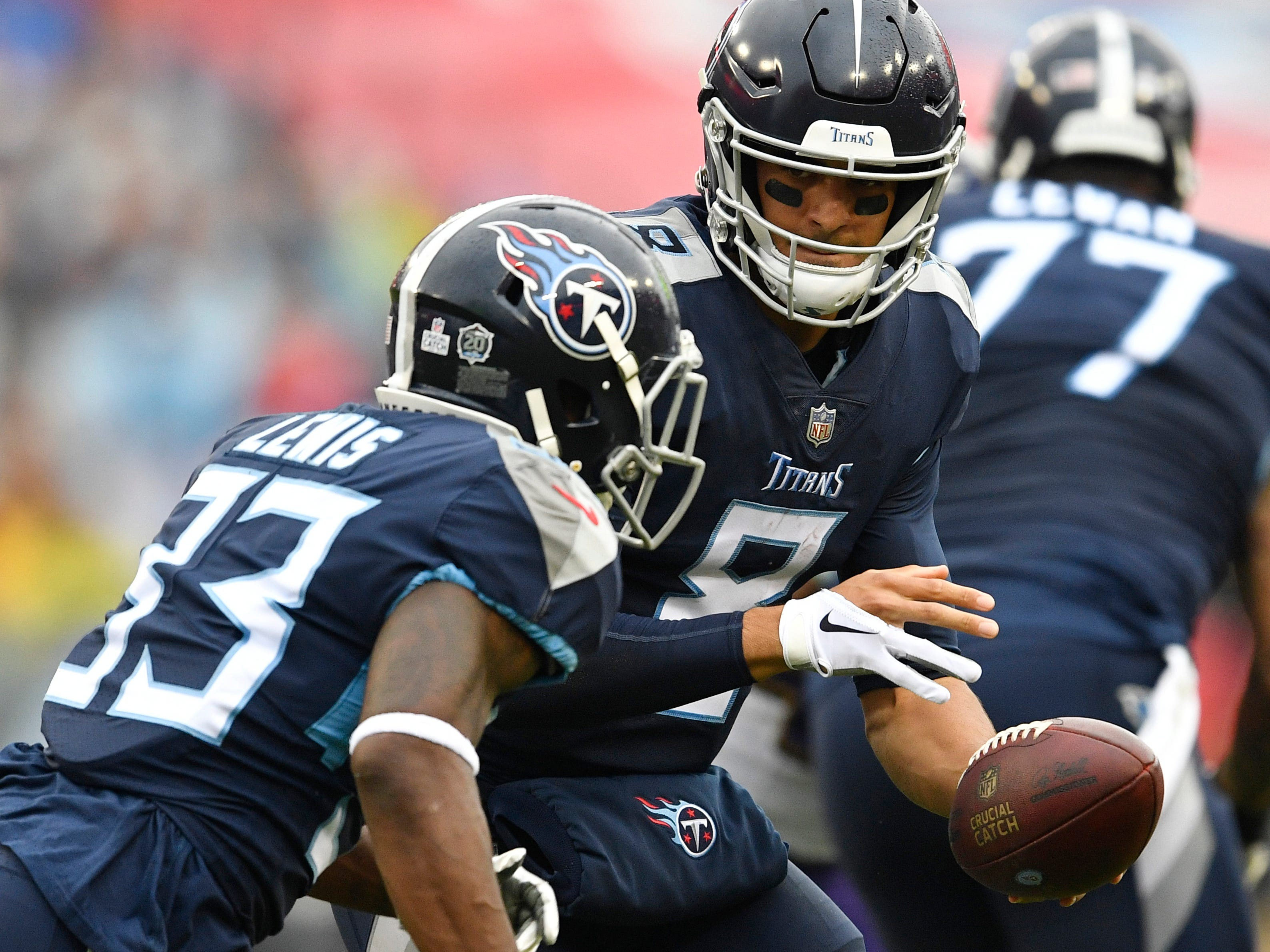 Titans quarterback Marcus Mariota (8) hands off to Titans running back Dion Lewis (33) in the first half at Nissan Stadium Sunday, Oct. 14, 2018, in Nashville, Tenn.