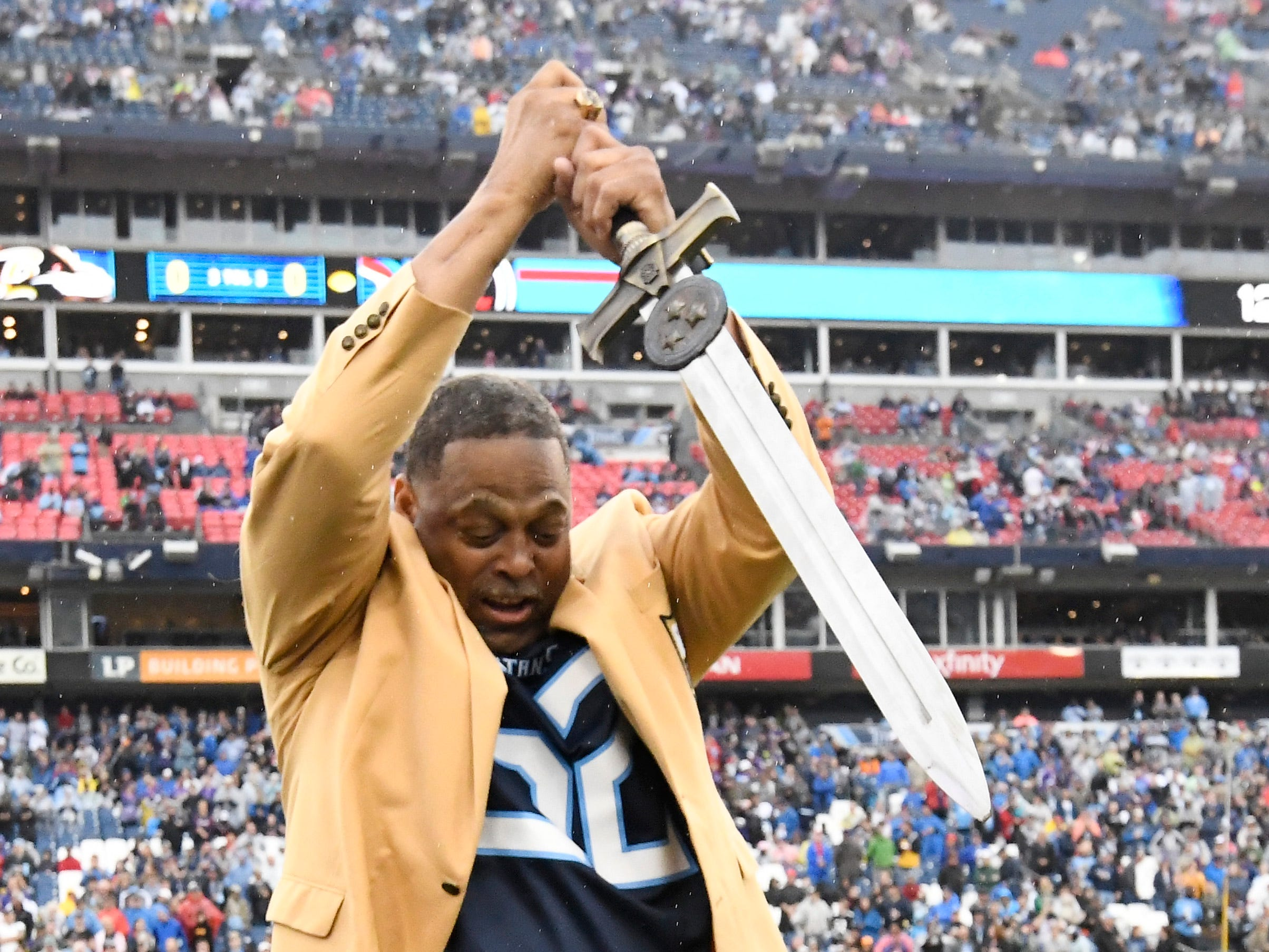 Houston Oilers Hall of Famer Robert Brazile does the Titans 12th Man duties before the game at Nissan Stadium Sunday, Oct. 14, 2018, in Nashville, Tenn.