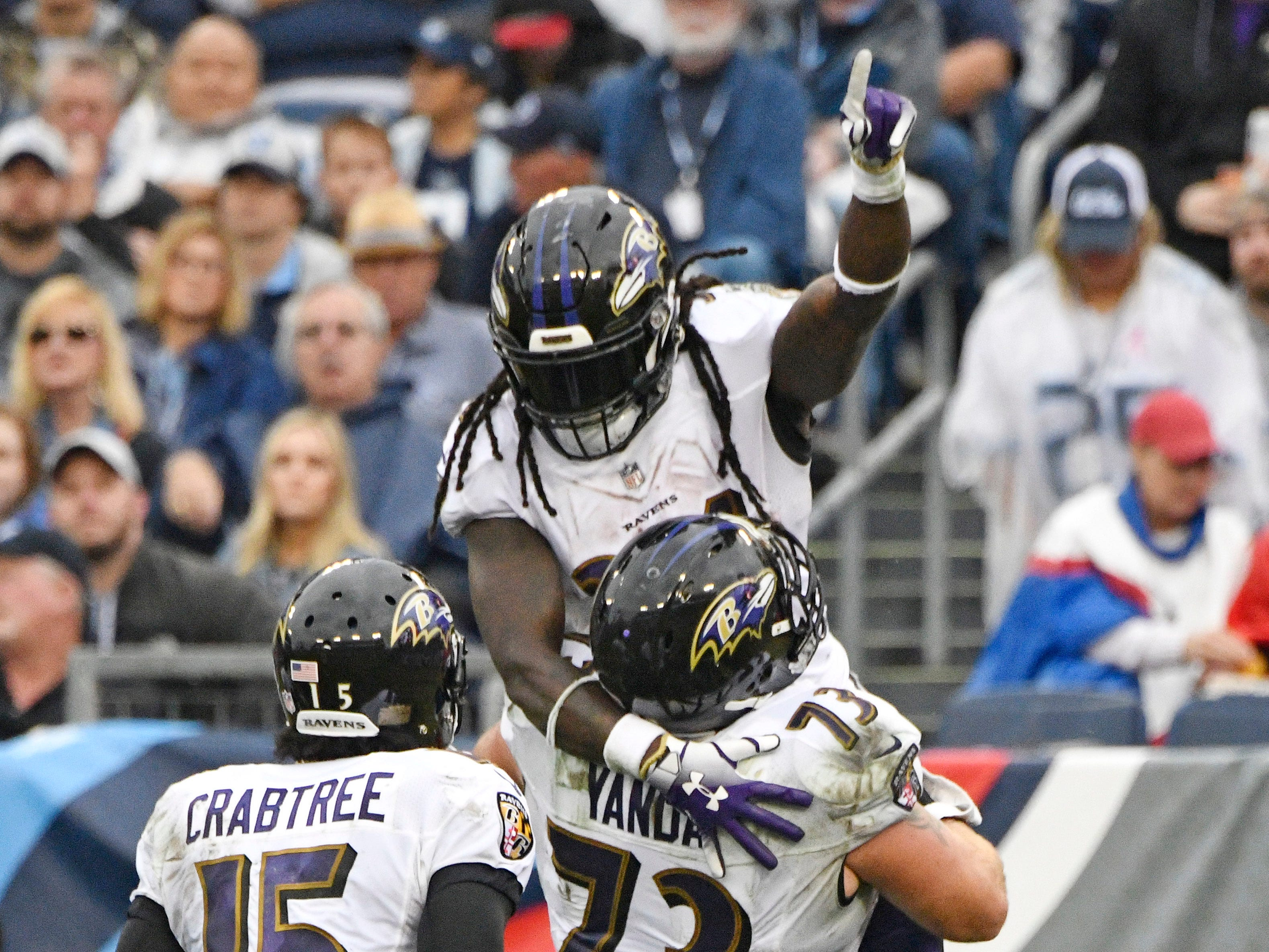 Ravens running back Alex Collins (34) celebrates his touchdown with Ravens offensive guard Marshal Yanda (73) In the second quarter at Nissan Stadium Sunday, Oct. 14, 2018, in Nashville, Tenn.