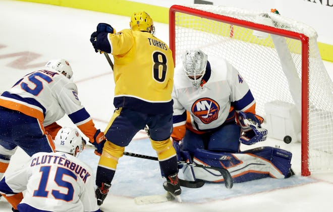 Nashville Predators center Kyle Turris (8) scores a goal against New York Islanders goaltender Robin Lehner (40), of Sweden, during the third period of an NHL hockey game Saturday, Oct. 13, 2018, in Nashville, Tenn.