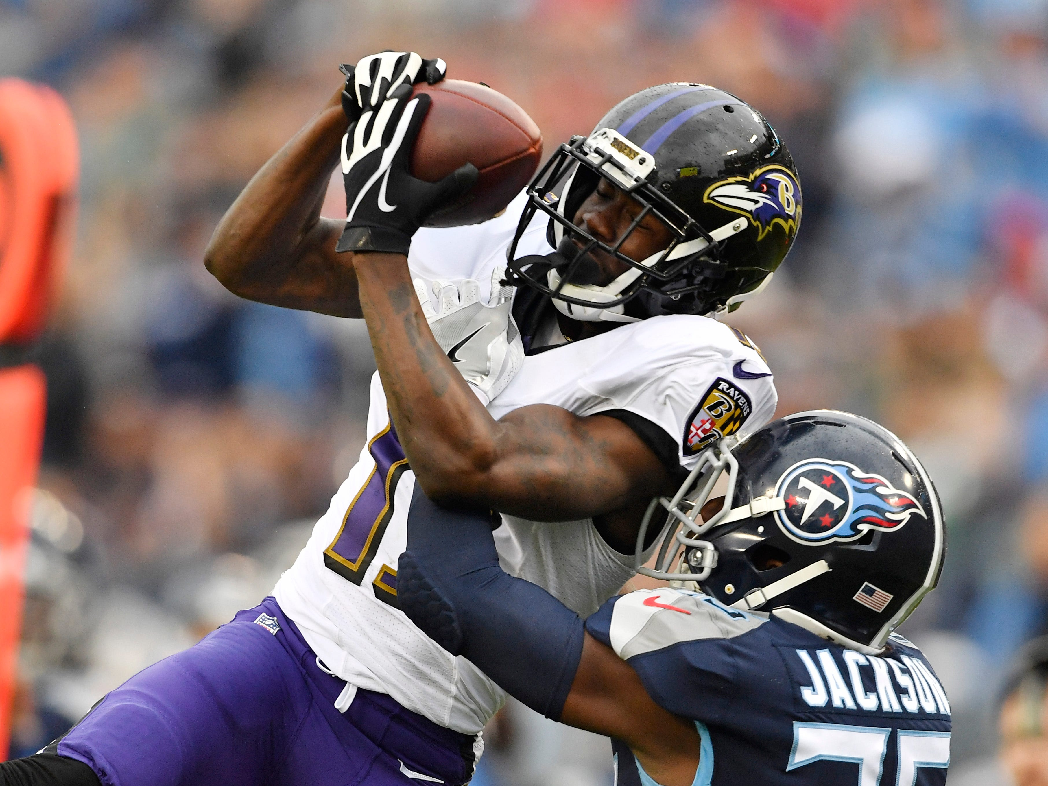 Ravens wide receiver John Brown (13) goes up for a catch over Titans cornerback Adoree' Jackson (25) in the second quarter at Nissan Stadium Sunday, Oct. 14, 2018, in Nashville, Tenn.