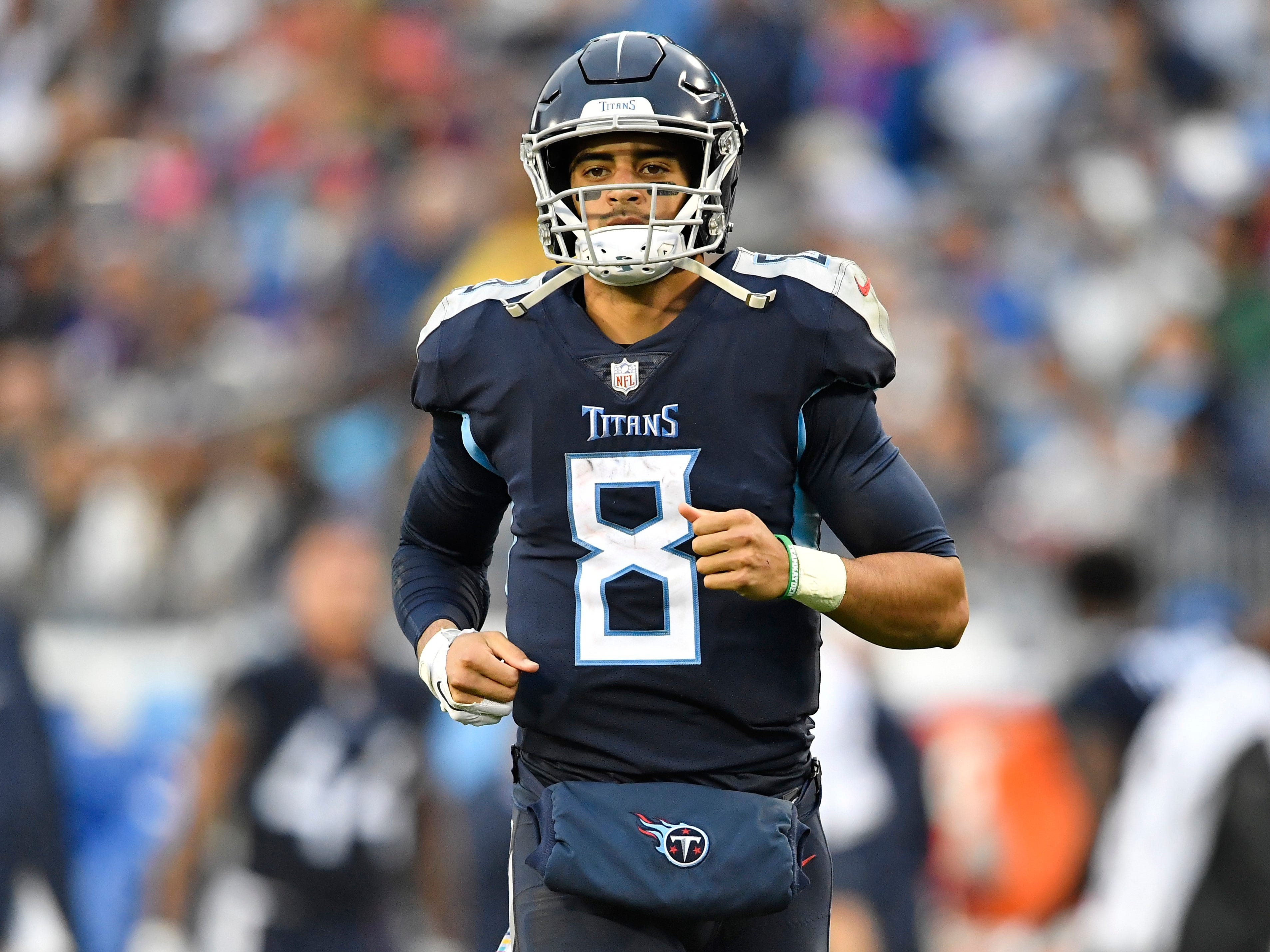Titans quarterback Marcus Mariota (8) jogs onto the field for a set of downs in the third quarter at Nissan Stadium Sunday, Oct. 14, 2018, in Nashville, Tenn.