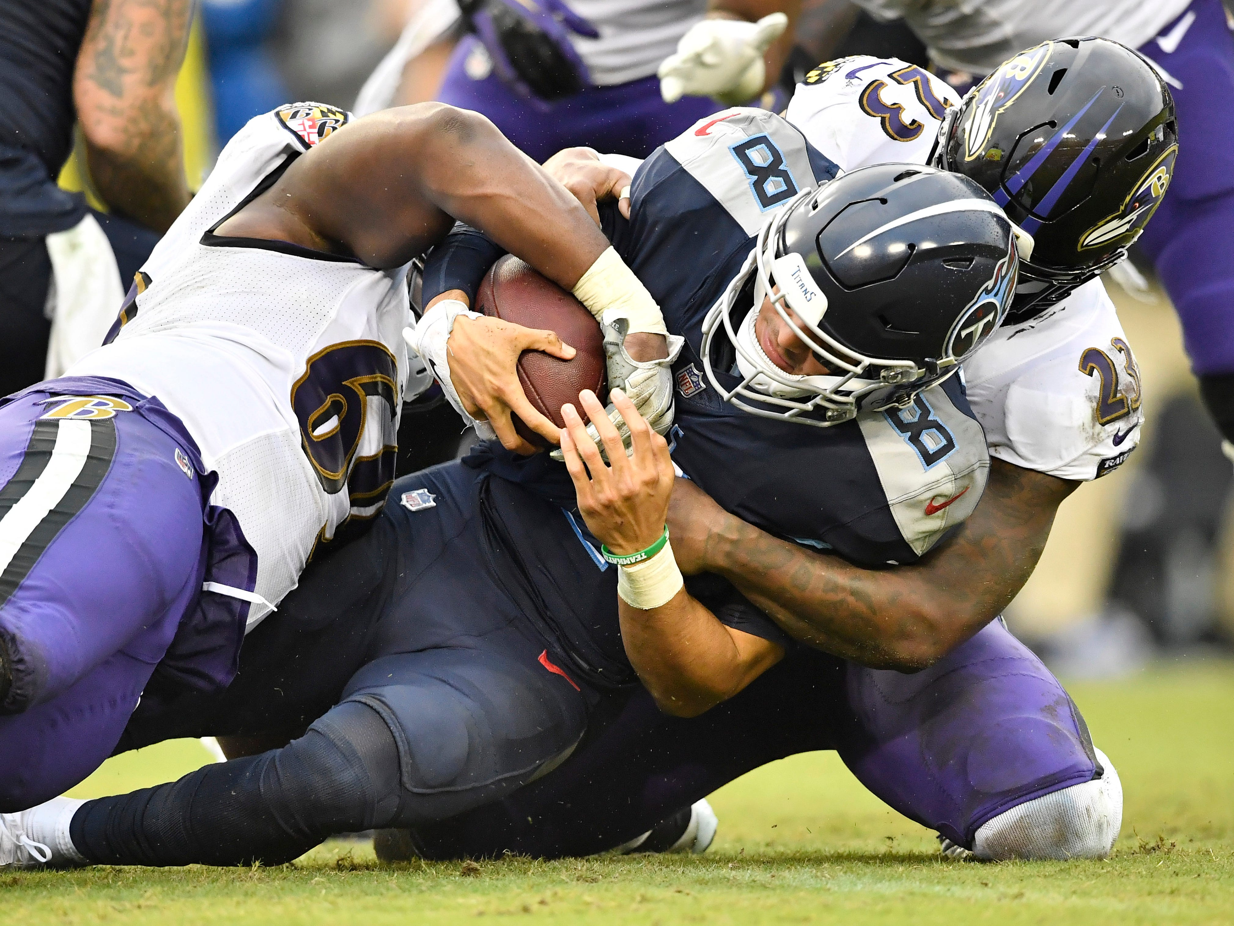 Worst performance: 11 sacks allowed vs. Ravens -- Ravens defensive tackle Willie Henry (69) and strong safety Tony Jefferson (23) sack Titans quarterback Marcus Mariota (8) in the third quarter at Nissan Stadium Sunday, Oct. 14, 2018, in Nashville, Tenn.