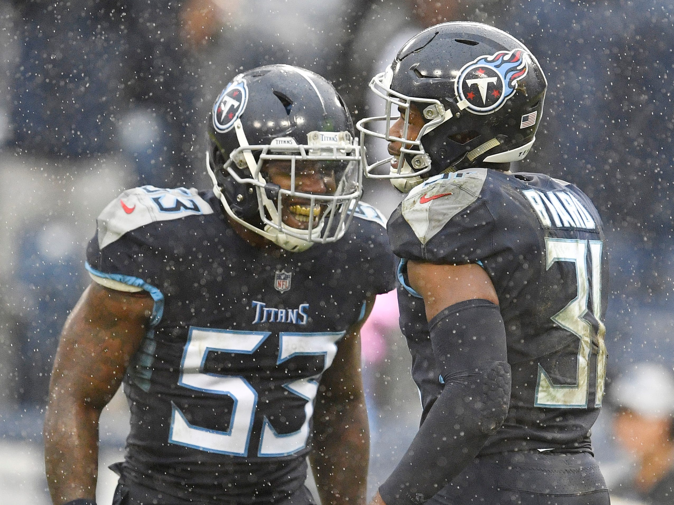 Titans linebacker Daren Bates (53) and free safety Kevin Byard (31) celebrate Byard's interception in the second quarter at Nissan Stadium Sunday, Oct. 14, 2018, in Nashville, Tenn.