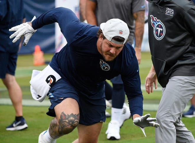 Titans offensive tackle Taylor Lewan warms up before the start of the game against the Ravens on Sunday.