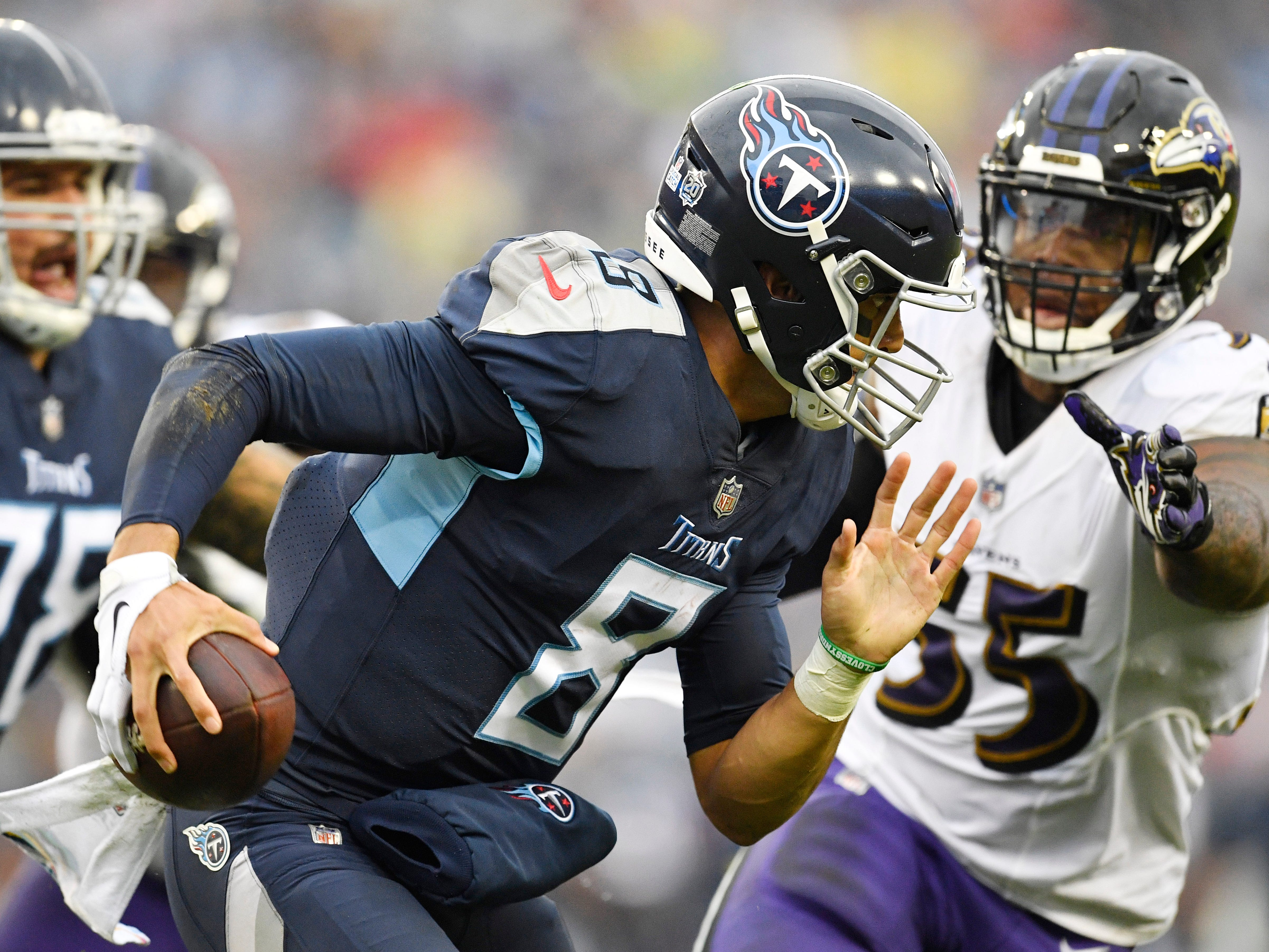 Titans quarterback Marcus Mariota (8) scrambles defended by Ravens linebacker Terrell Suggs (55) in the first half at Nissan Stadium Sunday, Oct. 14, 2018, in Nashville, Tenn.