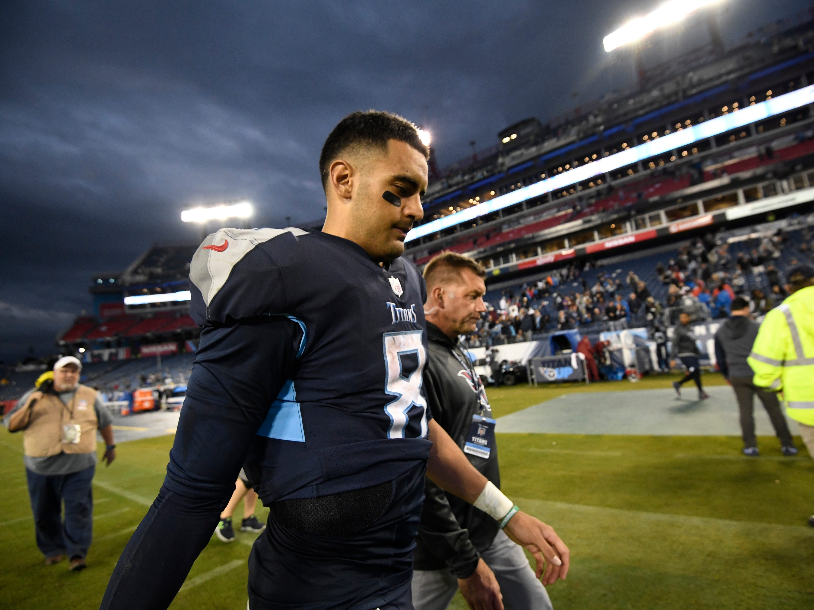 Titans quarterback Marcus Mariota (8) walks off the field after the team's 21-0 loss to the Ravens at Nissan Stadium Sunday, Oct. 14, 2018, in Nashville, Tenn.