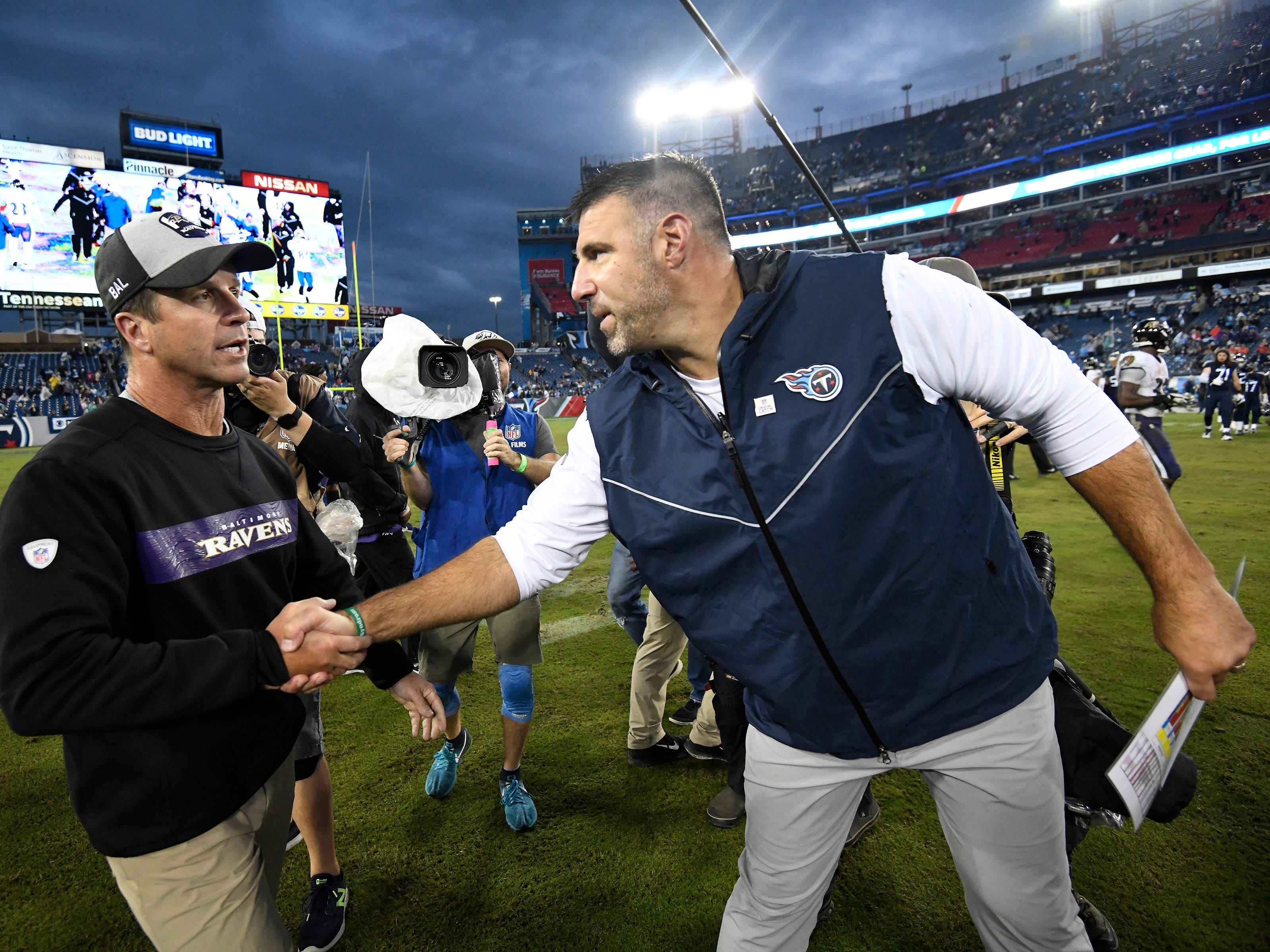 Titans head coach Mike Vrabel shakes hands with Ravens head coach John Harbaugh after the team's shutout loss at Nissan Stadium Sunday, Oct. 14, 2018, in Nashville, Tenn.