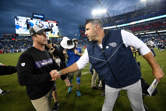 Titans coach Mike Vrabel shakes hands with Ravens coach John Harbaugh after the team's shutout loss Sunday at Nissan Stadium.