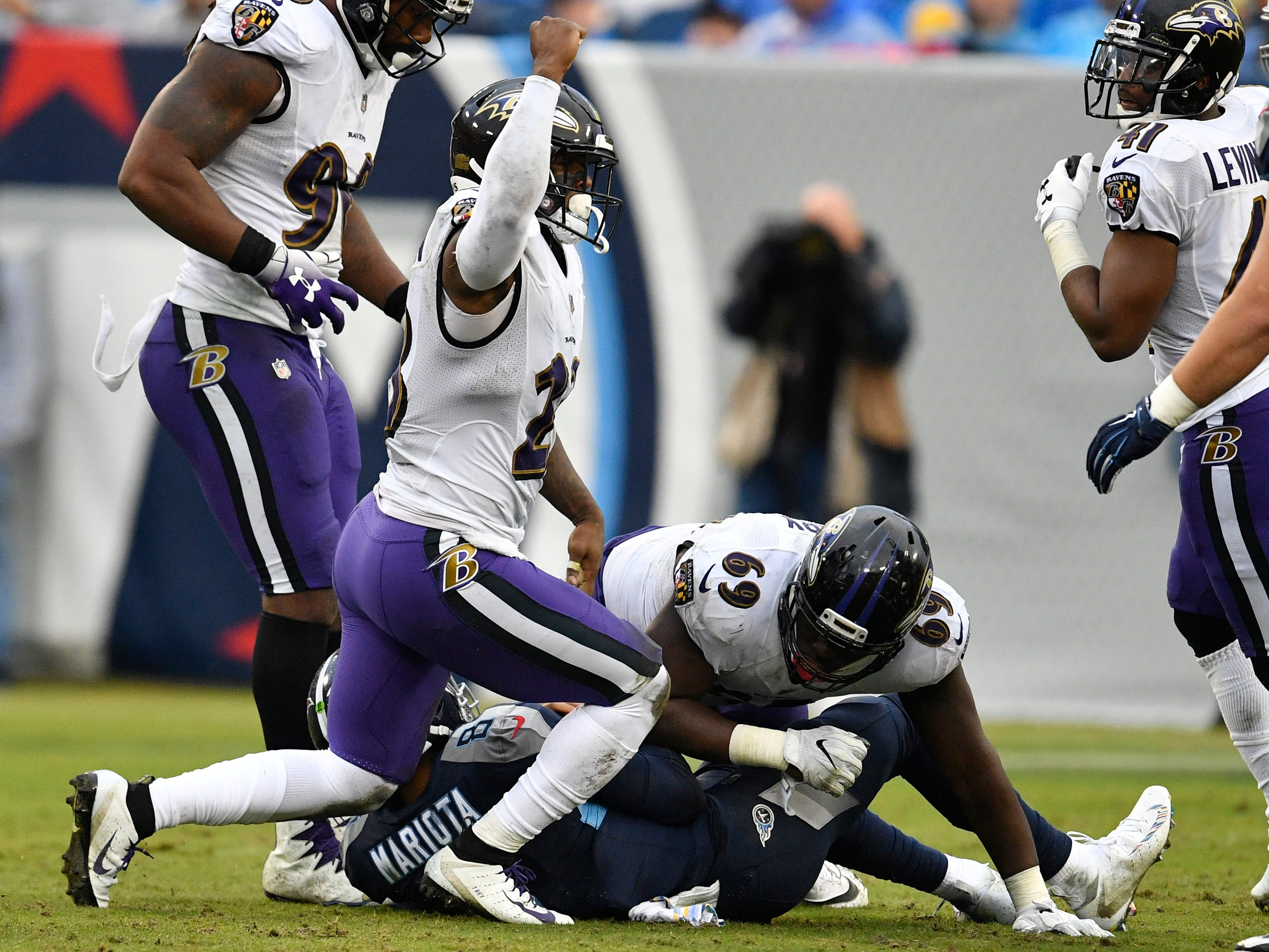 Ravens strong safety Tony Jefferson (23) celebrates taking down Titans quarterback Marcus Mariota (8) with Ravens defensive tackle Willie Henry (69) in the third quarter at Nissan Stadium Sunday, Oct. 14, 2018, in Nashville, Tenn.