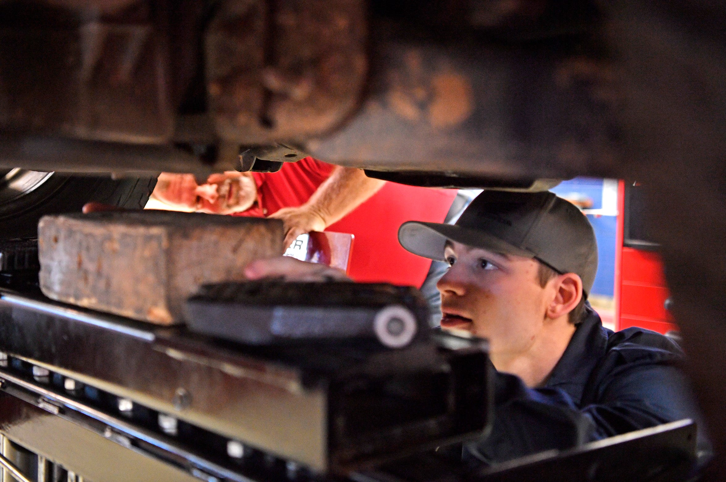 Instructor Mike McCord keeps a close eye on his student Morgan McAlpin at Tennessee College of Applied Technology in Hardeman County. McAlpin hopes to graduate in April and get a job as a mechanic full time. Thursday Oct. 11, 2018, in Bolivar, Tenn.