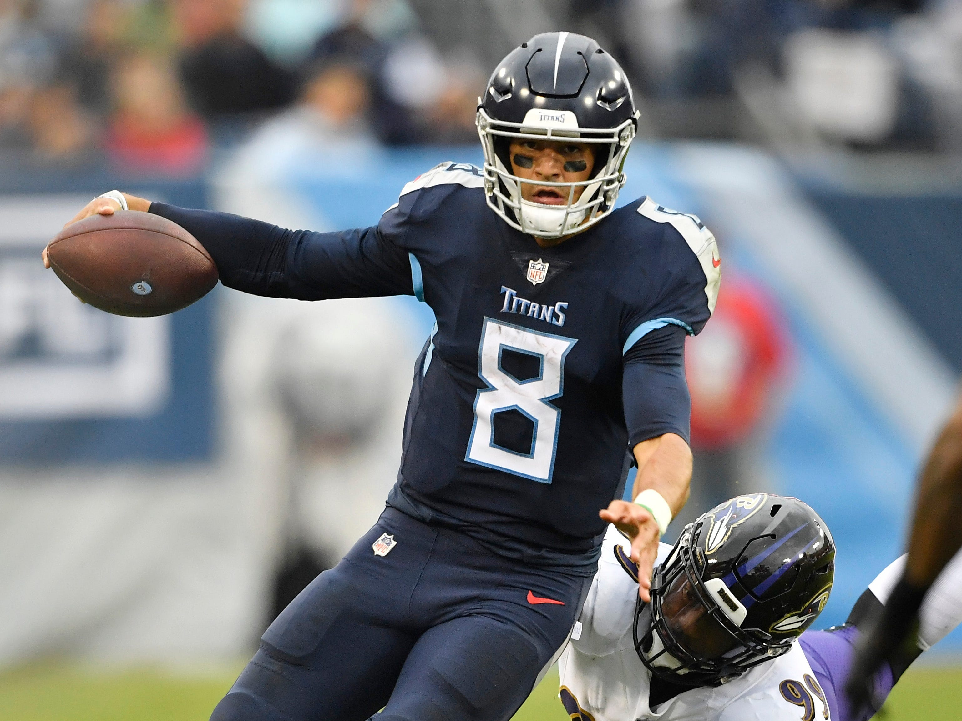 Titans quarterback Marcus Mariota (8) scrambles out of the pocket in the second quarter at Nissan Stadium Sunday, Oct. 14, 2018, in Nashville, Tenn.