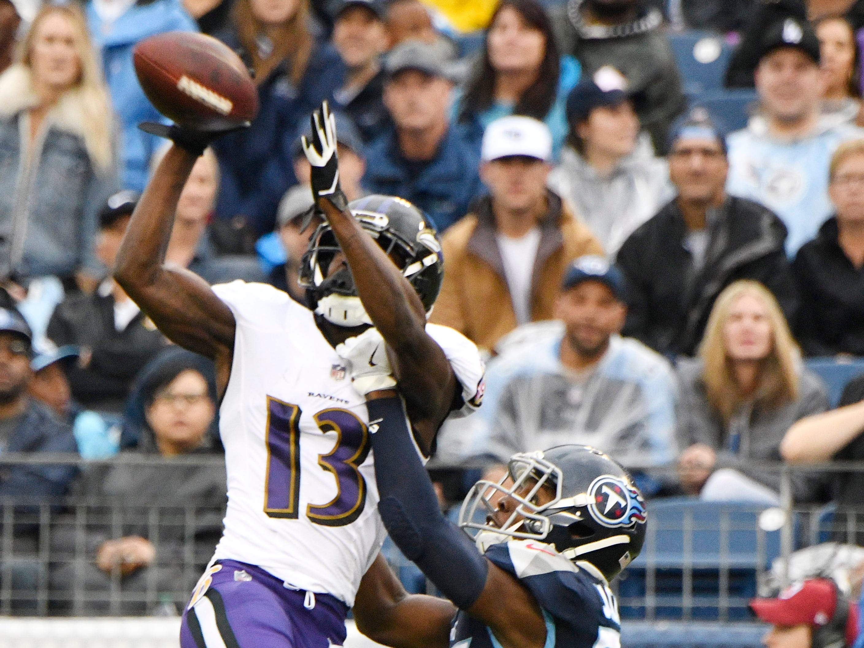 Ravens wide receiver John Brown (13) makes a catch over Titans cornerback Adoree' Jackson (25) in the second quarter at Nissan Stadium Sunday, Oct. 14, 2018, in Nashville, Tenn.