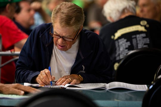 Don Peterson goes through the Greyhound Racing program booklet before beginning to bet at Naples Fort Myers Greyhound Racing & Poker on Friday afternoon, Oct. 12, 2018, for the Palm beach Greyhound Race.Peterson of Bonita Springs has been betting for nearly 50 years. Three years back, Peterson adopted Onteria, a 3-year-old greyhound racer. She was racing at the Palm Beach race today.