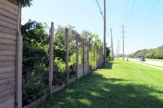 A concrete wall along the south side of Vanderbilt Beach Road in North Naples has been an eyesore since Hurricane Irma knocked out sections of it last fall.