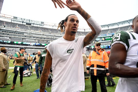 New York Jets wide receiver Robby Anderson high-fives a fan as he walks to the lockerroom after a 42-34 win over the Indianapolis Colts in Week 6 on Sunday, Oct. 14, 2018, in East Rutherford.