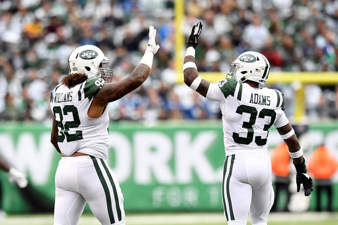 New York Jets defensive end Leonard Williams, left, and safety Jamal Adams celebrate an intentional grounding call against Indianapolis Colts quarterback Andrew Luck (not pictured) in the second half. The Jets defeat the Indianapolis Colts 42-34 in Week 6 on Sunday, Oct. 14, 2018, in East Rutherford.