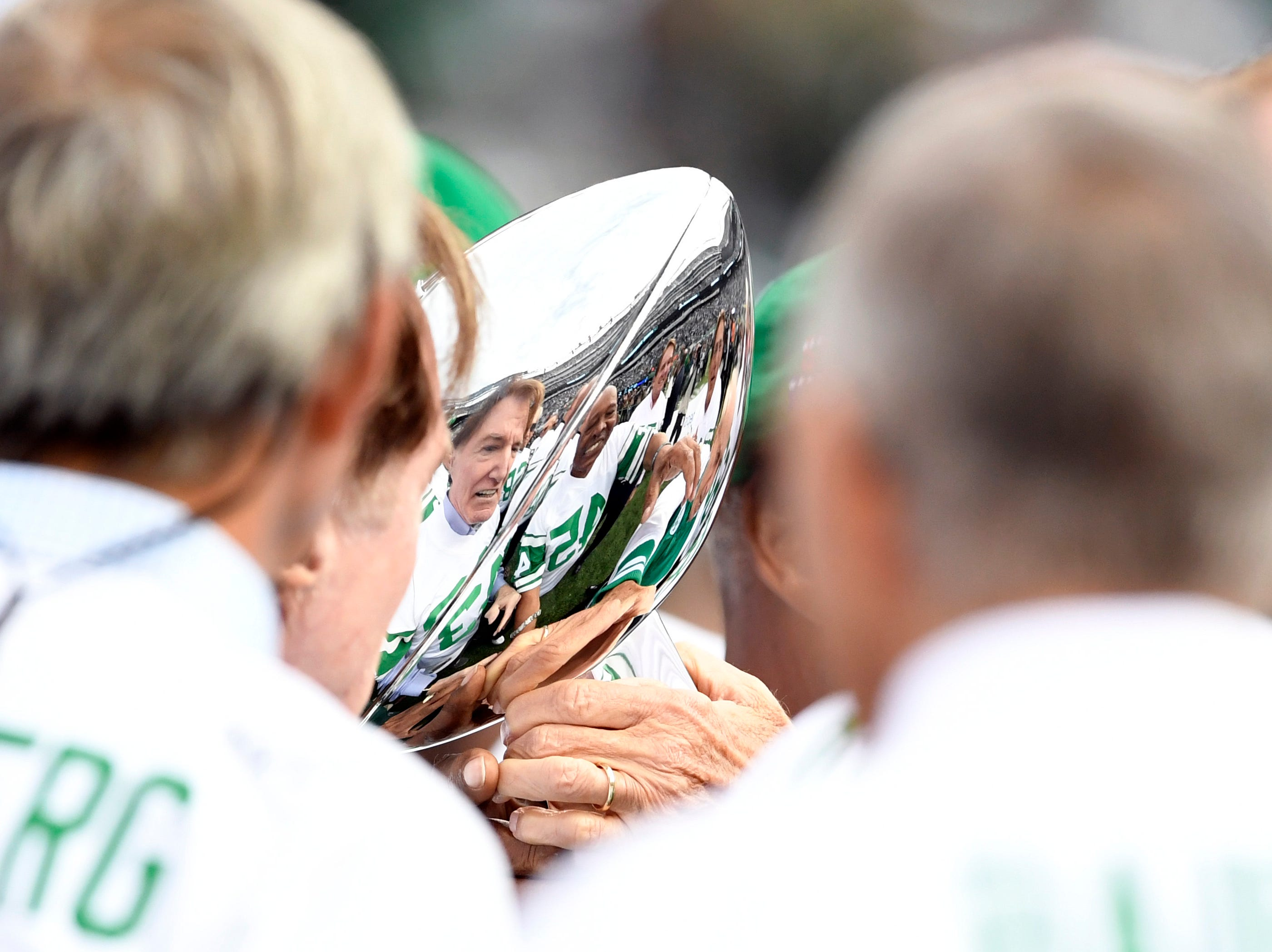 The 1968 Jets pass around the Super Bowl trophy during a halftime show honoring the Super Bowl III winning team. The New York Jets host the Indianapolis Colts in Week 6 on Sunday, Oct. 14, 2018, in East Rutherford.