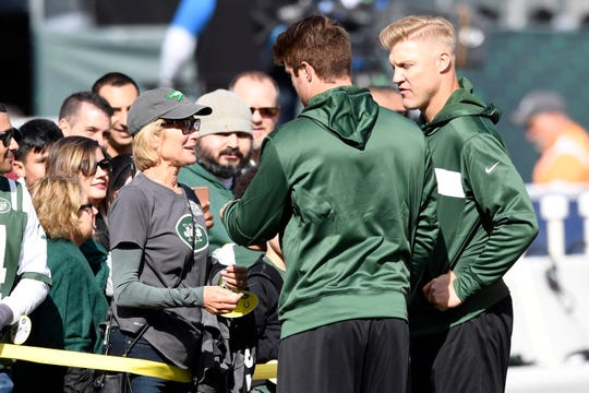 New York Jets quarterbacks Josh McCown, far right, and Sam Darnold talk to Darnold's mom Chris, far left, during warm-ups. The New York Jets host the Indianapolis Colts in Week 6 on Sunday, Oct. 14, 2018, in East Rutherford.