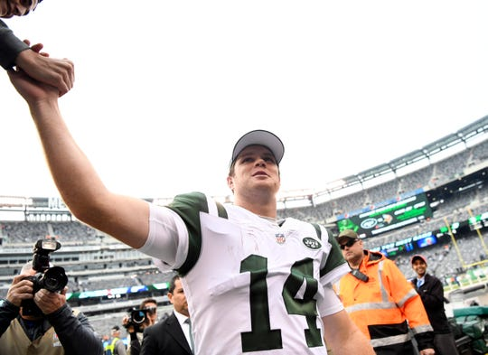 New York Jets quarterback Sam Darnold (14) high-fives a fan after his 42-34 win over the Indianapolis Colts in Week 6 on Sunday, Oct. 14, 2018, in East Rutherford.
