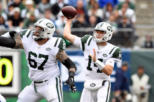 New York Jets quarterback Sam Darnold (14) throws the ball with coverage by guard Brian Winters (67) in the first half. The New York Jets host the Indianapolis Colts in Week 6 on Sunday, Oct. 14, 2018, in East Rutherford.