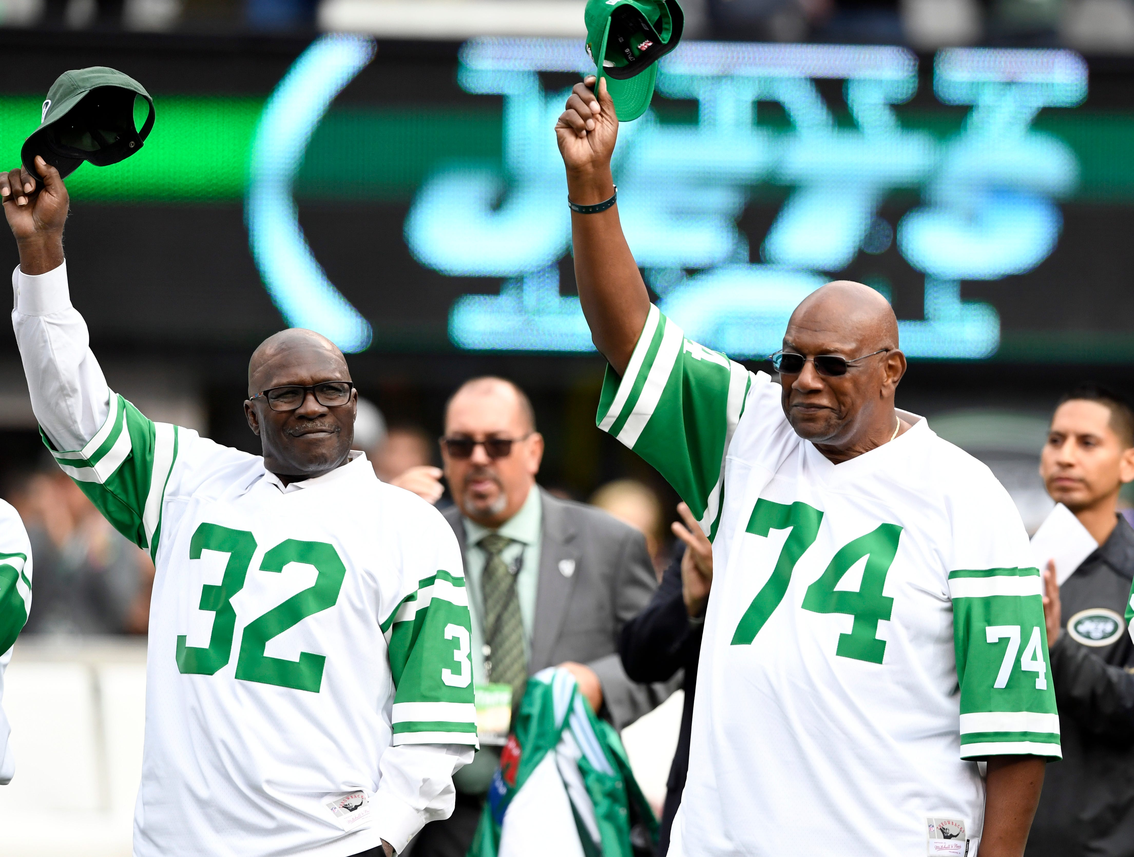 Former New York Jets greats Emerson Boozer (32) and Jeff Richardson (74) wave to the crowd as the 1968 team is honored during halftime. The New York Jets host the Indianapolis Colts in Week 6 on Sunday, Oct. 14, 2018, in East Rutherford.