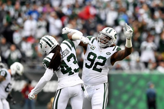 New York Jets cornerback Parry Nickerson (43) and defensive end Leonard Williams (92) celebrate a Colts fumble in the first half, resulting in a Jets ball. The New York Jets host the Indianapolis Colts in Week 6 on Sunday, Oct. 14, 2018, in East Rutherford.