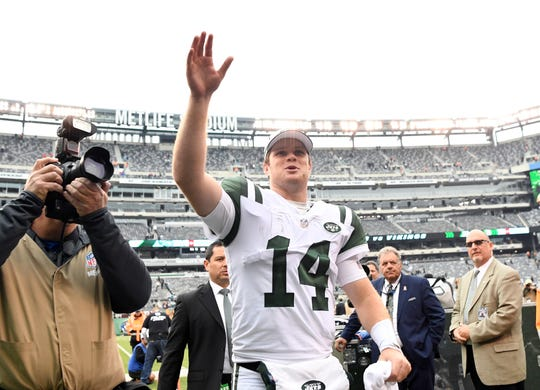 New York Jets quarterback Sam Darnold (14) waves to fans as he walks off the field after his 42-34 win over the Indianapolis Colts in Week 6 on Sunday, Oct. 14, 2018, in East Rutherford.