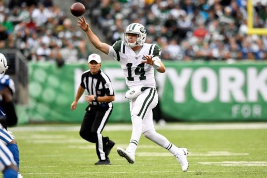 New York Jets quarterback Sam Darnold (14) throws on the run in the second half. The Jets defeat the Indianapolis Colts 42-34 in Week 6 on Sunday, Oct. 14, 2018, in East Rutherford.