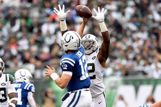 New York Jets defensive end Leonard Williams (92) puts pressure on Indianapolis Colts quarterback Andrew Luck (12) in the second half. The Jets defeat the Indianapolis Colts 42-34 in Week 6 on Sunday, Oct. 14, 2018, in East Rutherford.