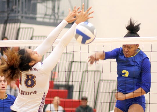 Junior Talleyshia Morris, right, gets her spike past the WNMU block from Deyzha Samuelu during Saturday's Texas A&M University-Kingsville's win over the Western New Mexico Mustangs at Deming High School.