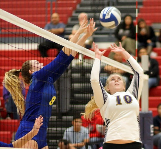 Mustangs' setter Sophia Mitchell (10) saves an errant pass from the big block of Javelina senior Haley Hitchinson.
