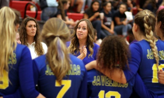 Coach Tanya Allen (center), a Gatorade All-American during her playing days at Deming High School, tends to her Texas A&M University-Kingsville team during Saturday's Lone Star Conference volleyball match against the Western New Mexico University Mustangs at Deming High.