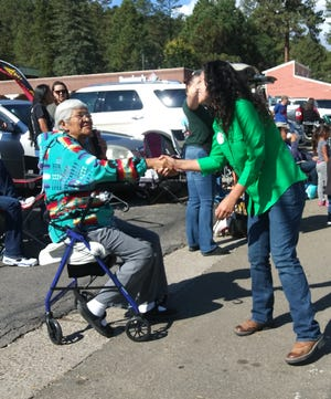 Congressional candidate Xochitl Small greets people during the Aspenfest Parade in Ruidoso