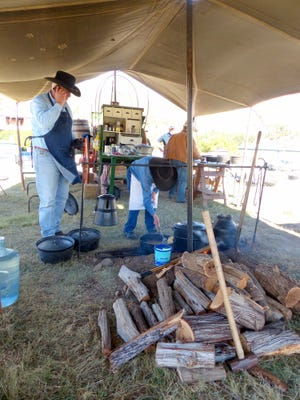 Cooks at the C Bar C chuckwagon prepare for the lunch meal.
