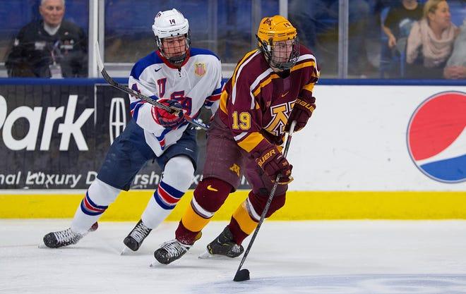 Minnesota forward Scott Reedy (19), formerly of the U.S. NTDP Under-18 team, maintains a step on Team USA's Judd Caulfield (14).