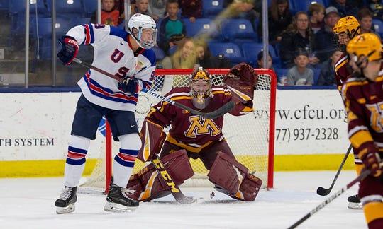 Team USA's Matthew Boldy (9) tries to tip a shot past Minnesota goalie Eric Schierhorn.