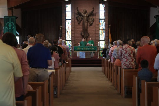 Parishioners attend Sunday Mass at Sacred Heart Catholic Church in Palm Desert, Calif., October 14, 2018. Monsignor Howard Lincoln addressed the sexual assault allegations against Peter McCormick, who was a priest at Sacred Heart from 1984 to 2000, during Mass.