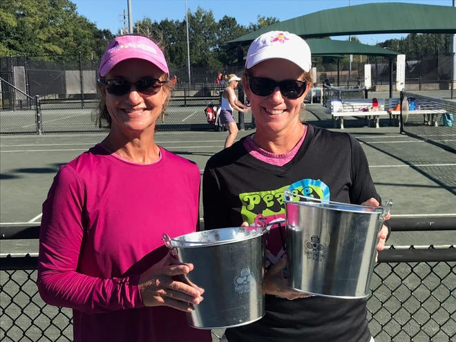 2018 Bud Light Charity Challenge Tennis Tournament champions Susan Nitterauer and Michelle Covell with their prize ice buckets after winning doubles.