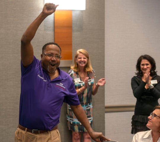 IMPACT 100 Pensacola Bay Area recipients celebrate Sunday, Oct. 14, 2018, after receiving a grant for $100,300 at the organization's awards ceremony at the Hilton Pensacola Beach.