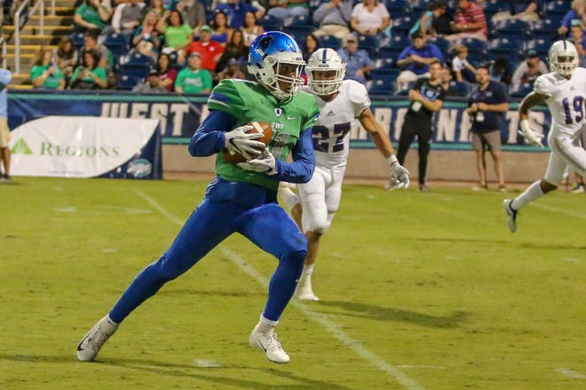 West Florida wide receiver Ishmel Morrow (11) makes a catch and runs in for a touchdown against West Georgia in the UWF homecoming game at Blue Wahoos Stadium on Saturday, October 13, 2018. Ranked No. 10 before the start of the game, the Argos lost to the undefeated Wolves, ranked No. 4, 27-7 in front of 6,838 fans, the largest home crowd to date. West Florida falls to 5-2 on the season and West Georgia improves to 7-0.