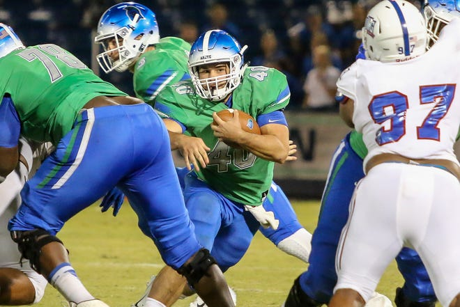 West Florida running back Chris Schwarz (40) goes up the middle against West Georgia in the UWF homecoming game at Blue Wahoos Stadium on Saturday, October 13, 2018. Ranked No. 10 before the start of the game, the Argos lost to the undefeated Wolves, ranked No. 4, 27-7 in front of 6,838 fans, the largest home crowd to date. West Florida falls to 5-2 on the season and West Georgia improves to 7-0.