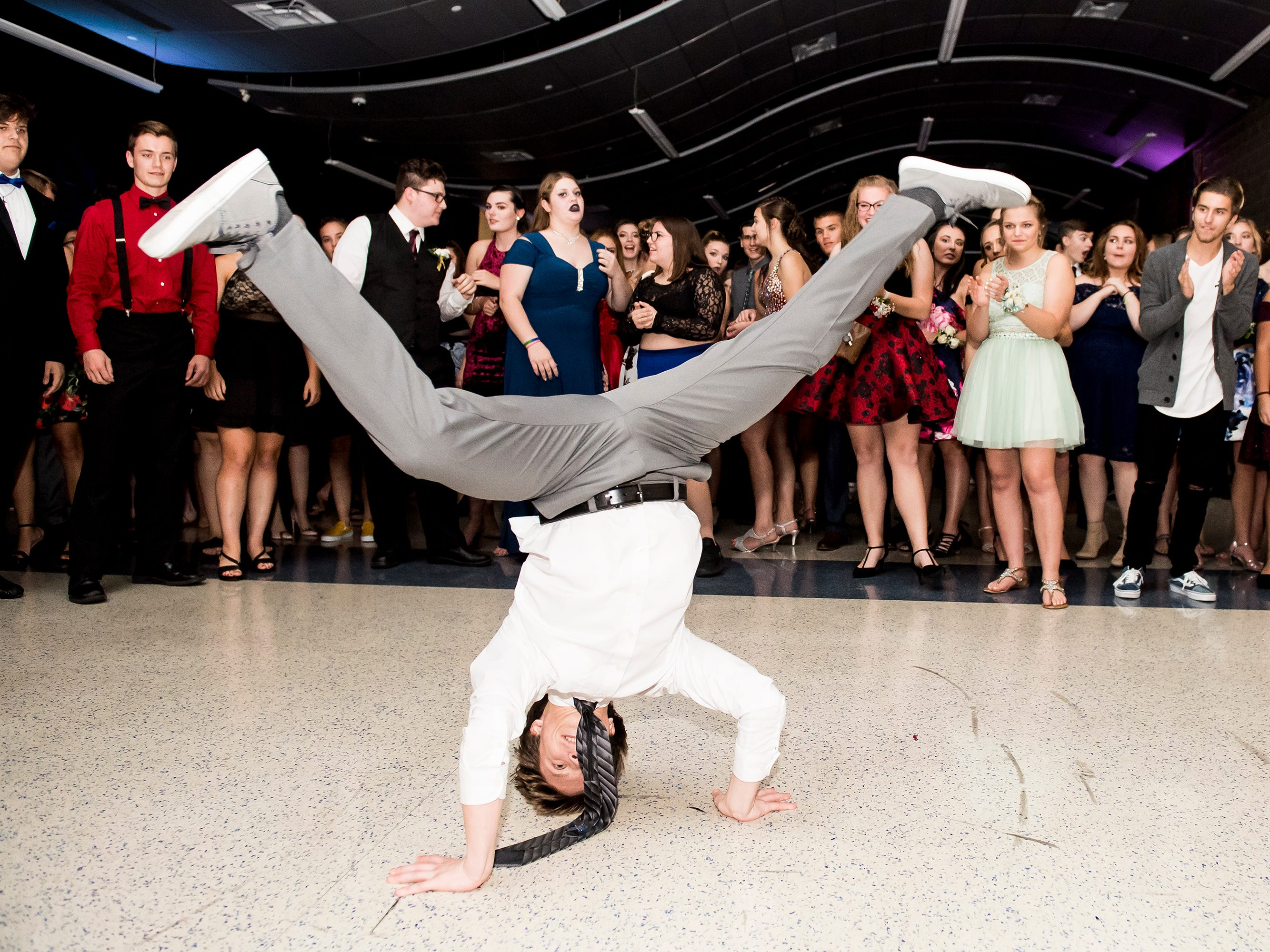 Toby Trish breakdances during Spring Grove Area High School's homecoming dance on Saturday, October 13, 2018.