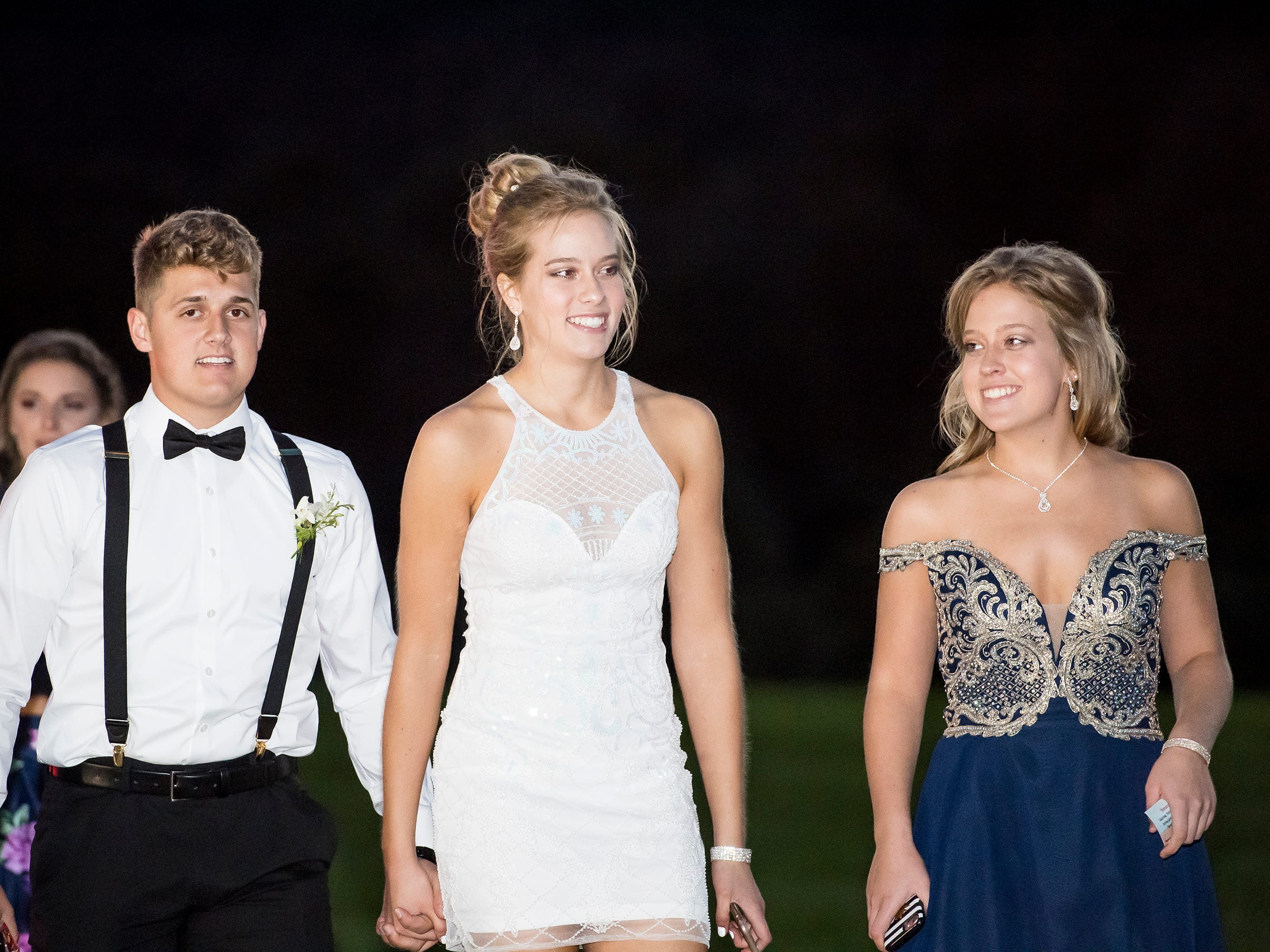 Students arrive at Spring Grove Area High School's homecoming dance on Saturday, October 13, 2018.
