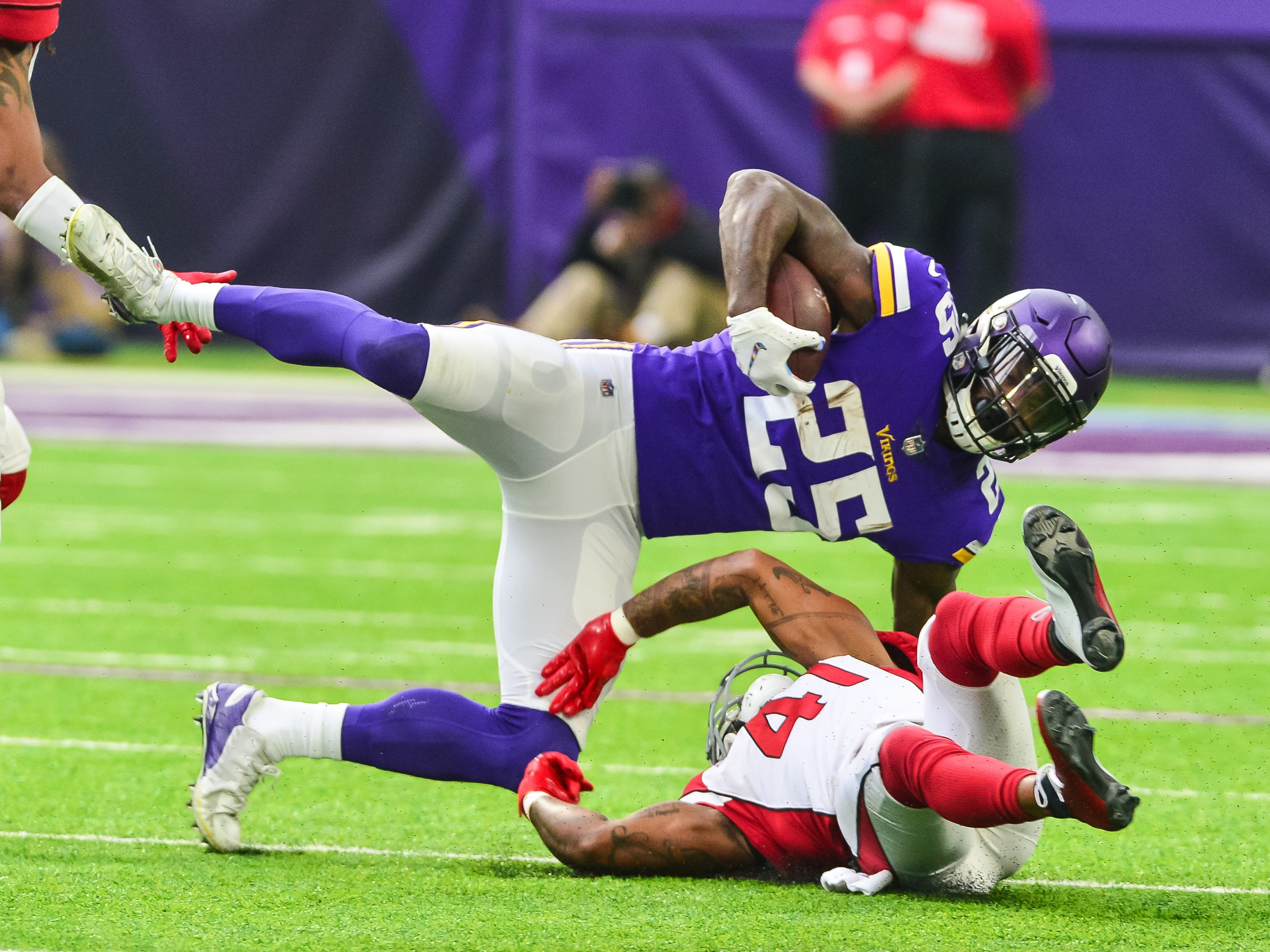 Oct 14, 2018; Minneapolis, MN, USA; Minnesota Vikings running back Latavius Murray (25) is tackled by Arizona Cardinals free safety Antoine Bethea (41) during the first quarter at U.S. Bank Stadium. Mandatory Credit: Jeffrey Becker-USA TODAY Sports