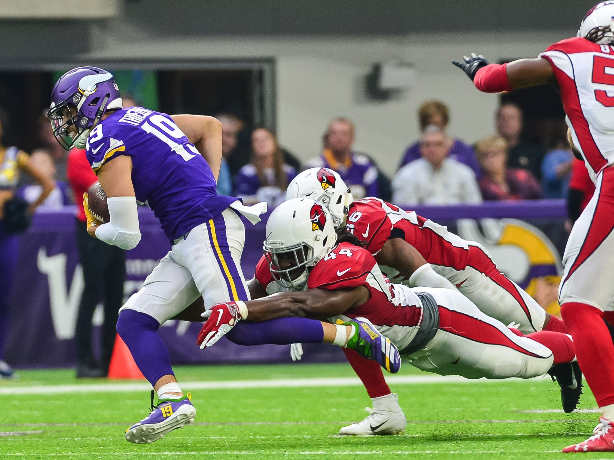 Oct 14, 2018; Minneapolis, MN, USA; Minnesota Vikings wide receiver Adam Thielen (19) is tackled by Arizona Cardinals defensive end Markus Golden (44) during the second quarter at U.S. Bank Stadium. Mandatory Credit: Jeffrey Becker-USA TODAY Sports