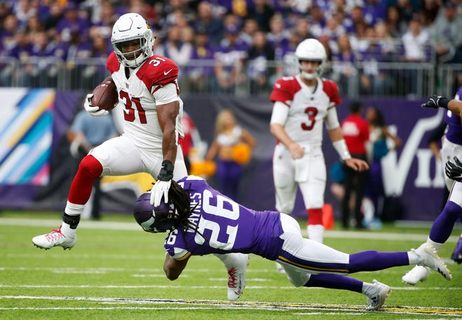 Arizona Cardinals running back David Johnson (31) breaks a tackle by Minnesota Vikings cornerback Trae Waynes (26) during the first half of an NFL football game, Sunday, Oct. 14, 2018, in Minneapolis. (AP Photo/Bruce Kluckhohn)