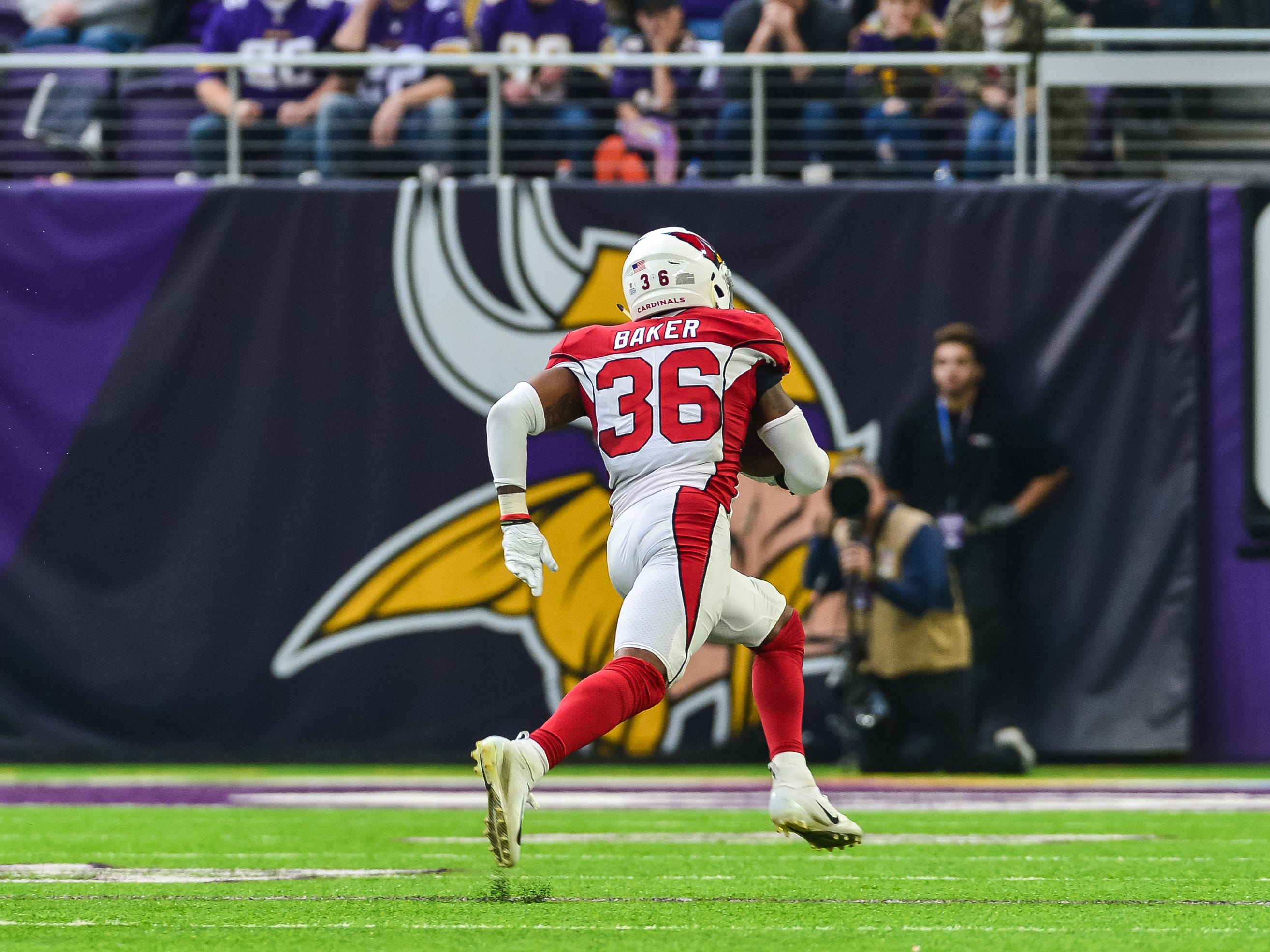 Oct 14, 2018; Minneapolis, MN, USA; Arizona Cardinals strong safety Budda Baker (36) returns a fumble by Minnesota Vikings quarterback Kirk Cousins (not pictured) for a touchdown during the second quarter at U.S. Bank Stadium. Mandatory Credit: Jeffrey Becker-USA TODAY Sports